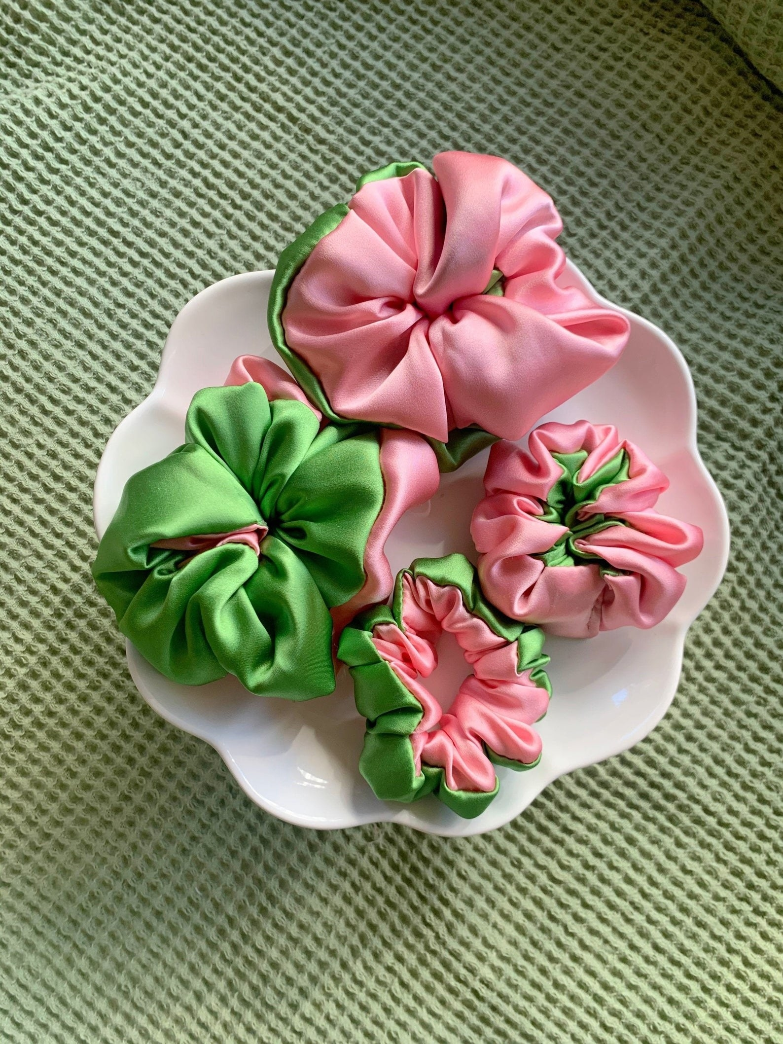 pink and green scrunchies in a bowl