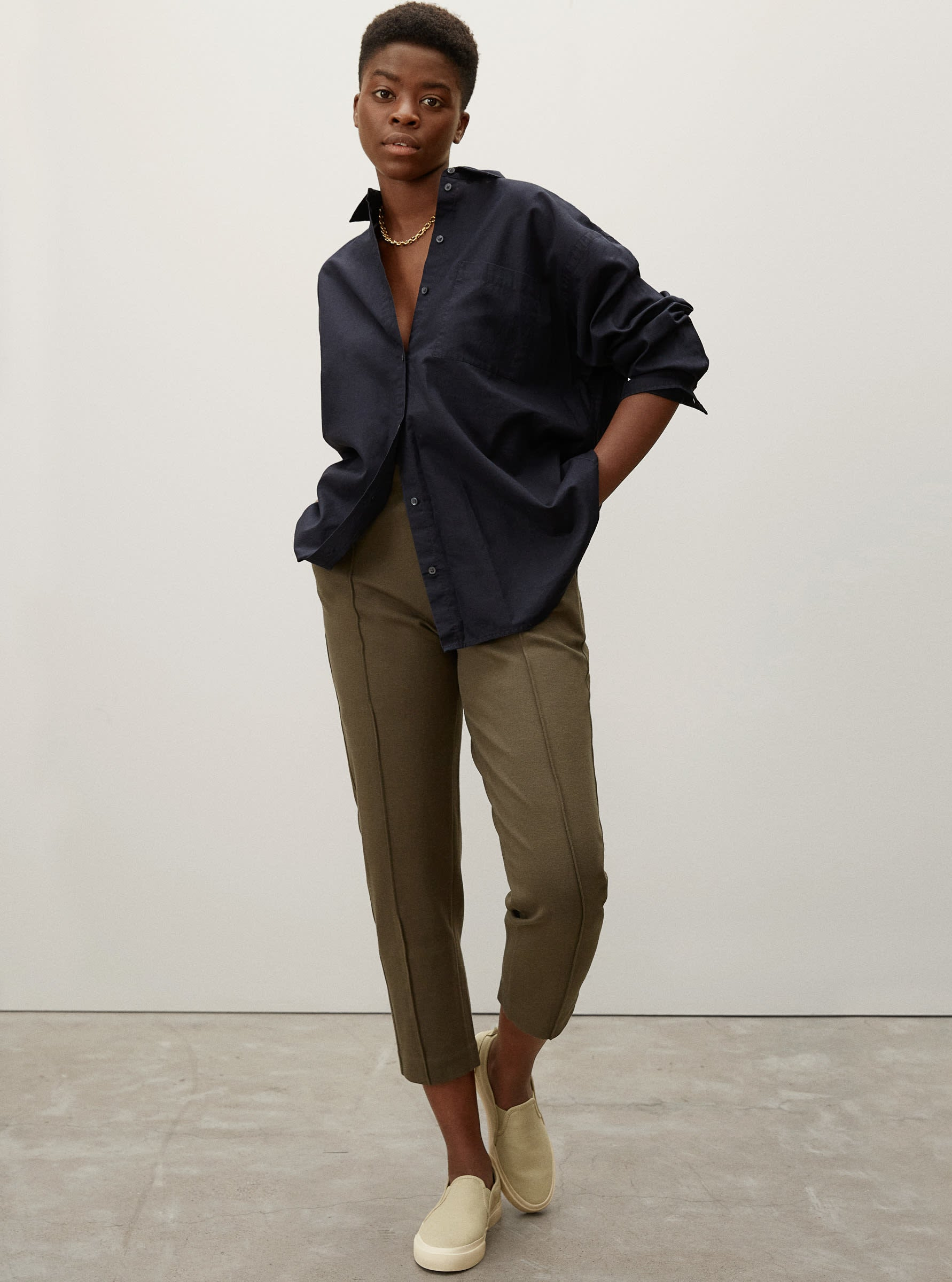 model wearing the green tapered pants