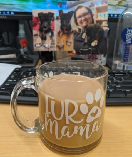 "The coffee mug with words ""fur mama"" on it"