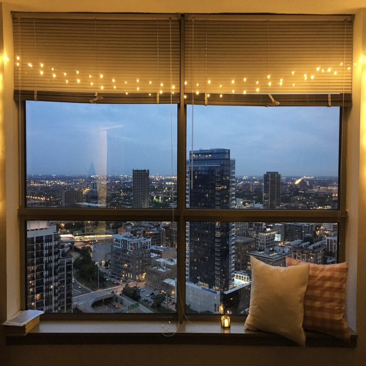 reviewer photo of string lights hanging over their windows
