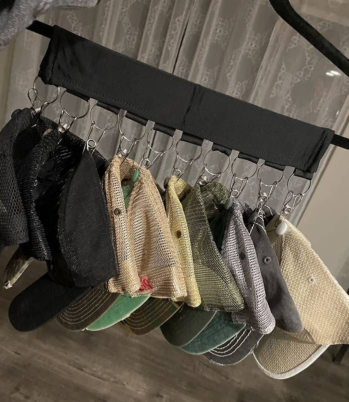 reviewer image of the hat organizer with neat stack of hats