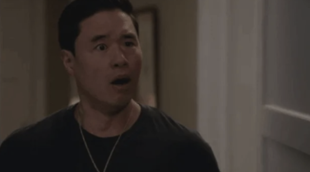 Randall Park with his jaw dropped