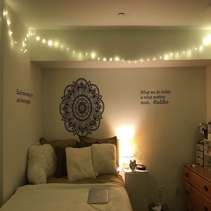 reviewer photo of string lights in their bedroom