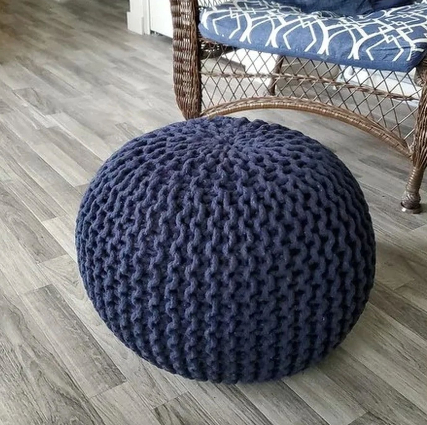 The knitted pouf ottoman in blue