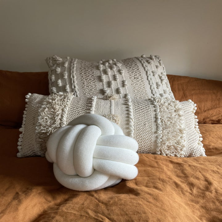 the white pillow on a BuzzFeeder editor's bed