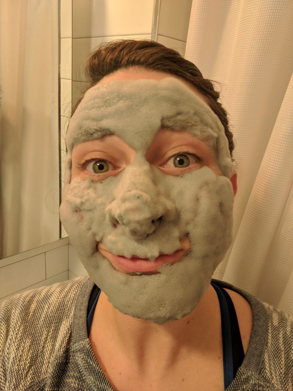 reviewer image of a customer's face covered in the foaming Elizavecca Milky Piggy Carbonated Bubble Clay Mask