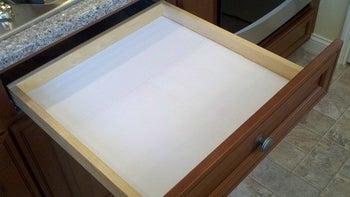 white liner inside a drawer
