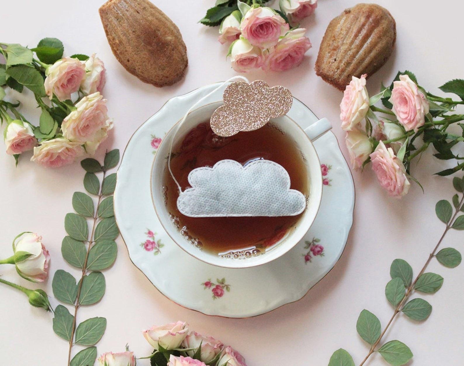 cloud-shaped tea bag floating in cup of tea