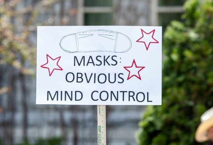 """Sign reading, """"Masks: Obvious Mind Control"""""""
