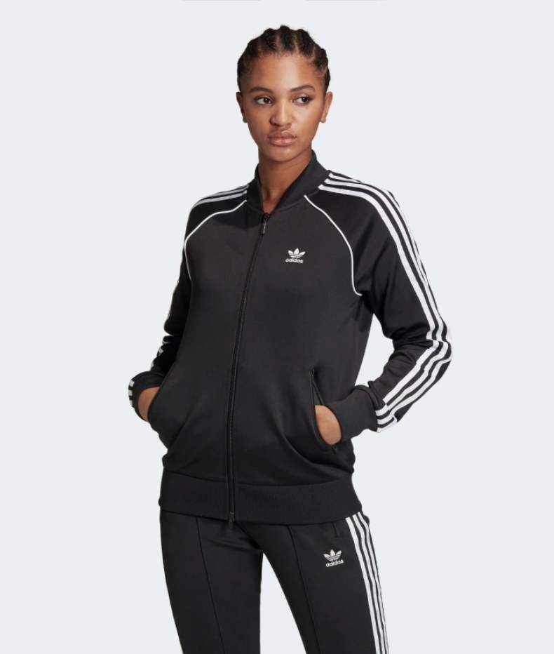 Model wearing black adidas tracksuit