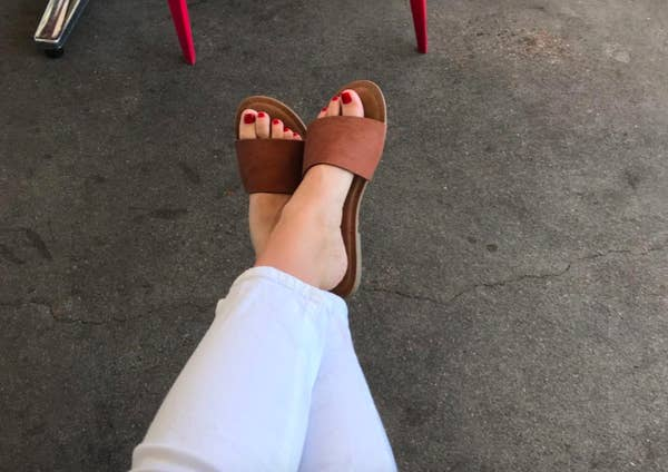 Reviewer wearing the tan slides