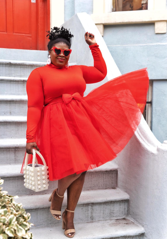 reviewer wearing monochromatic outfit with red tulle skirt and a matching long sleeve shirt