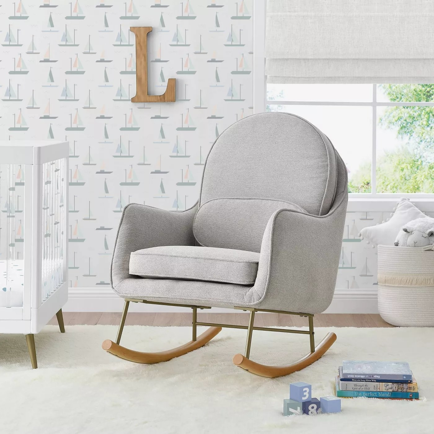The rocking chair with a matching lumbar pillow in a nursery