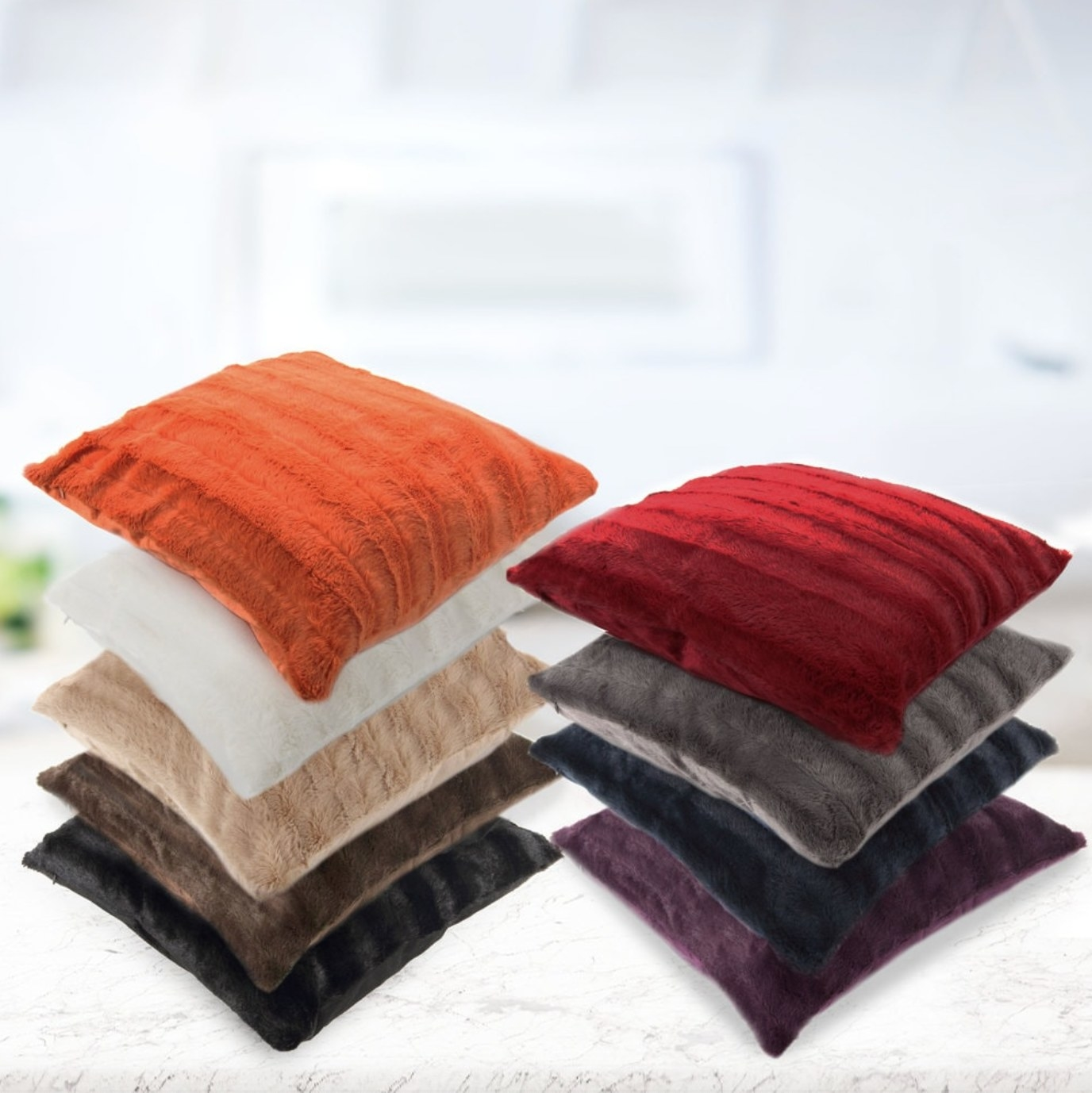 The faux fur throw pillows in multiple colors