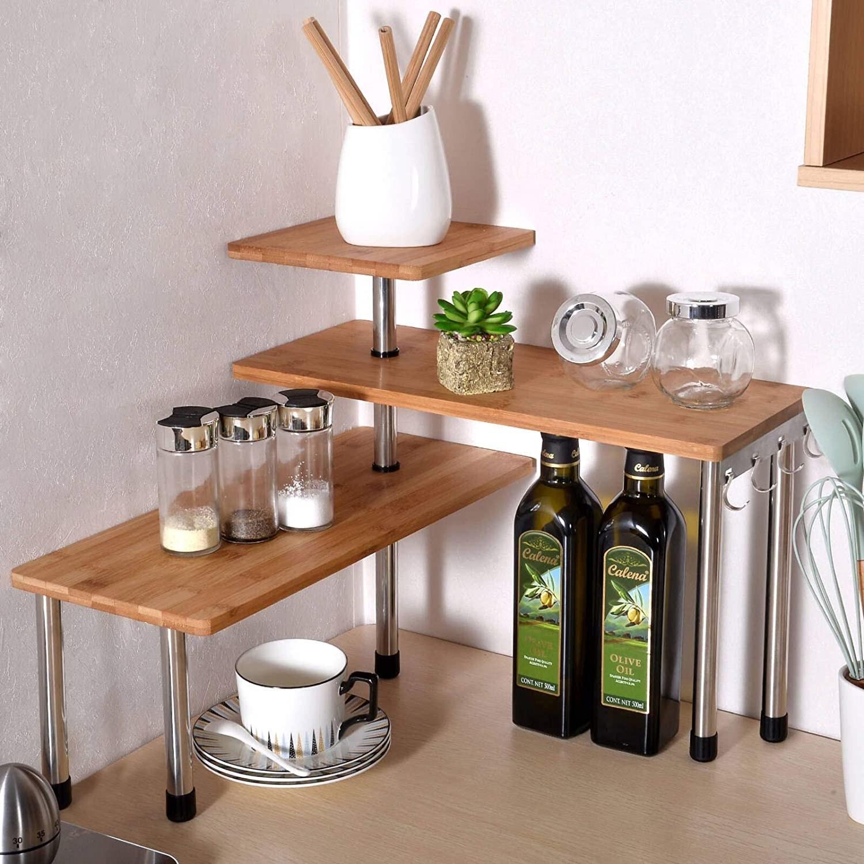 a three-tiered shelf with kitchen essentials on it