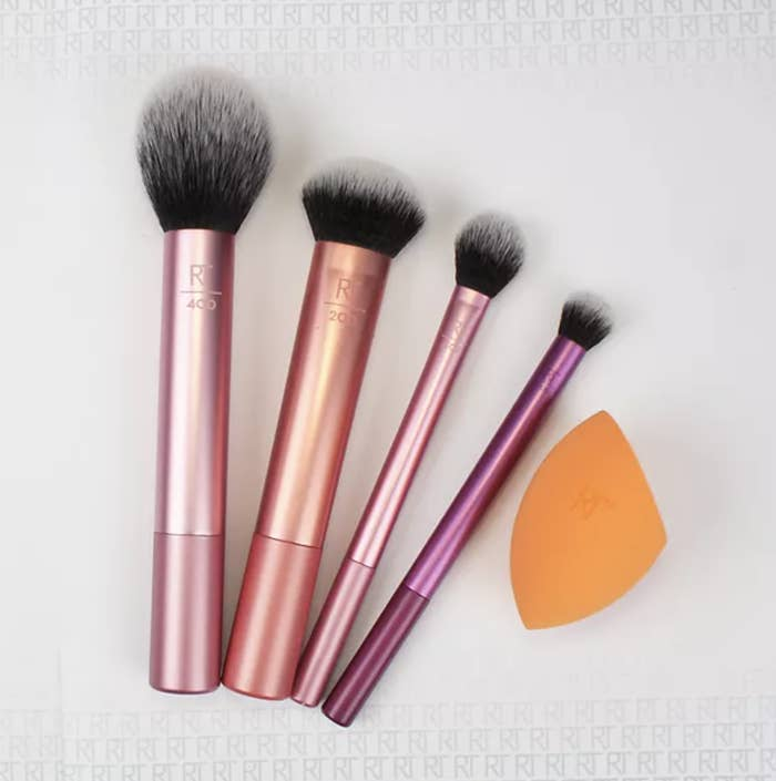 the brush set with purple and pink brushes and an orange blending sponge
