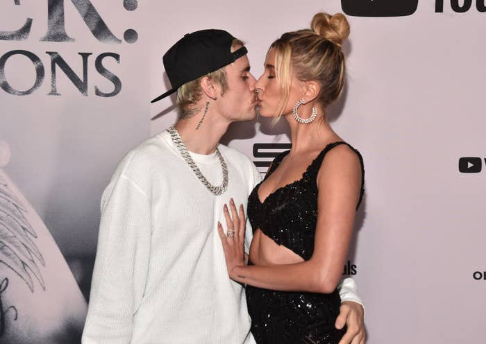 Justin and Hailey kissing on a red carpet