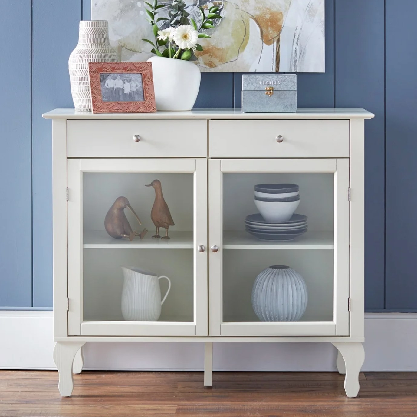 The glass cabinet in white