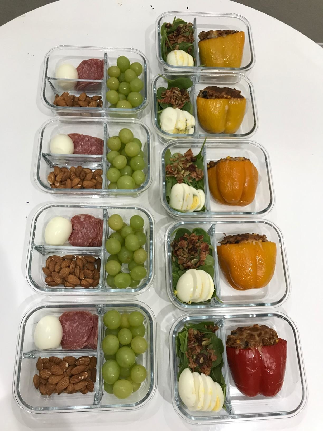 The containers laid out on a counter, with prepped food inside them
