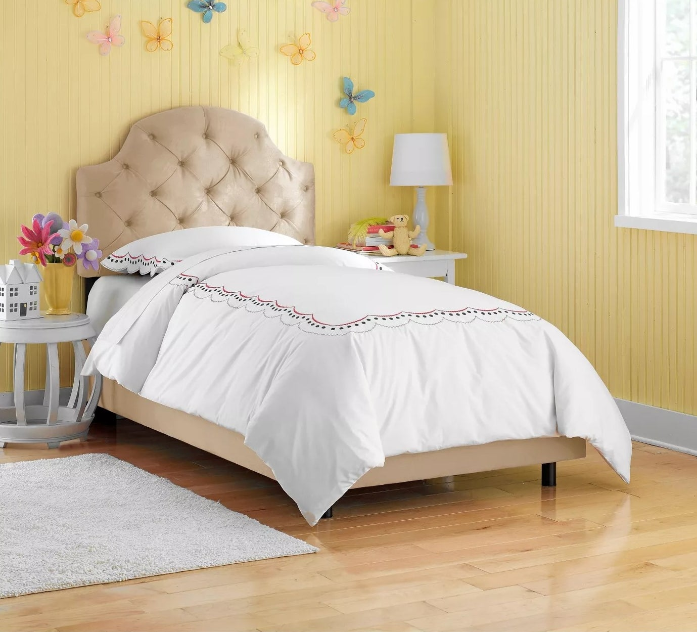 The tan twin bed in a child's room
