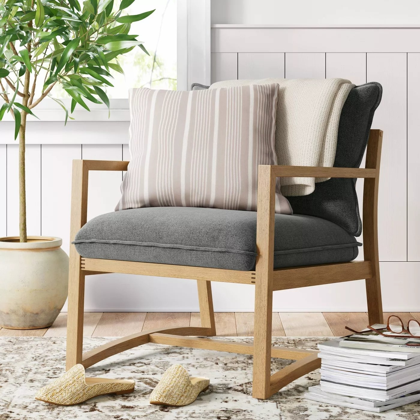 The armchair with an open wooden frame and two seat cushions