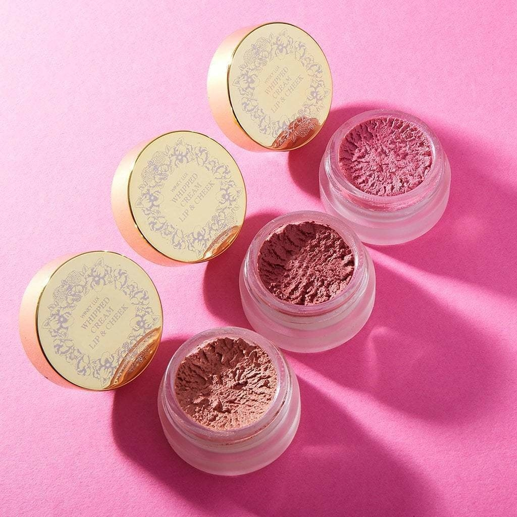 the three shades of whipped lip and cheek cream in tiny clear pots