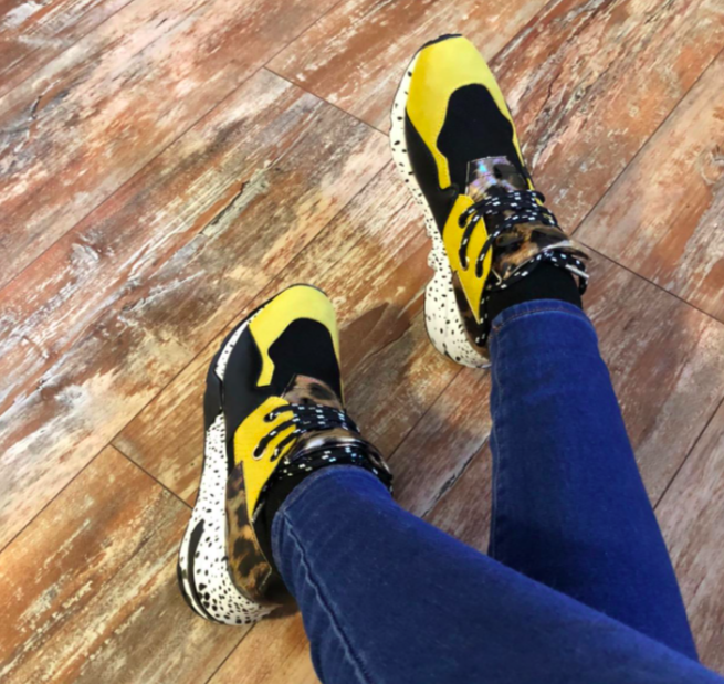 Reviewer wearing the yellow and cheetah print sneaker