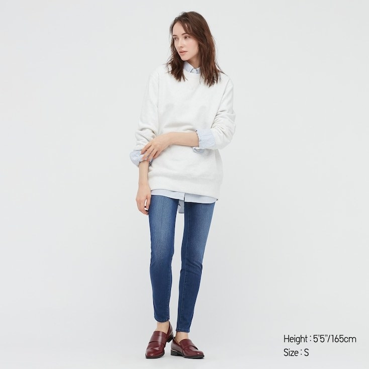 Model wearing Uniqlo stretch denim leggings