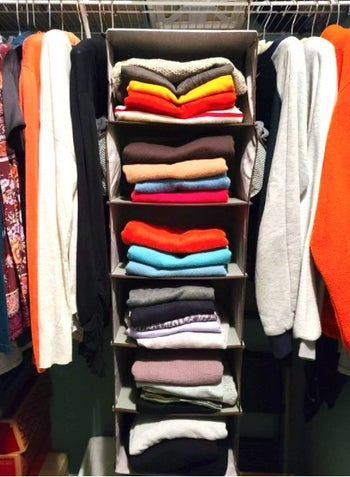 hanging closet organizer with sweatshirts