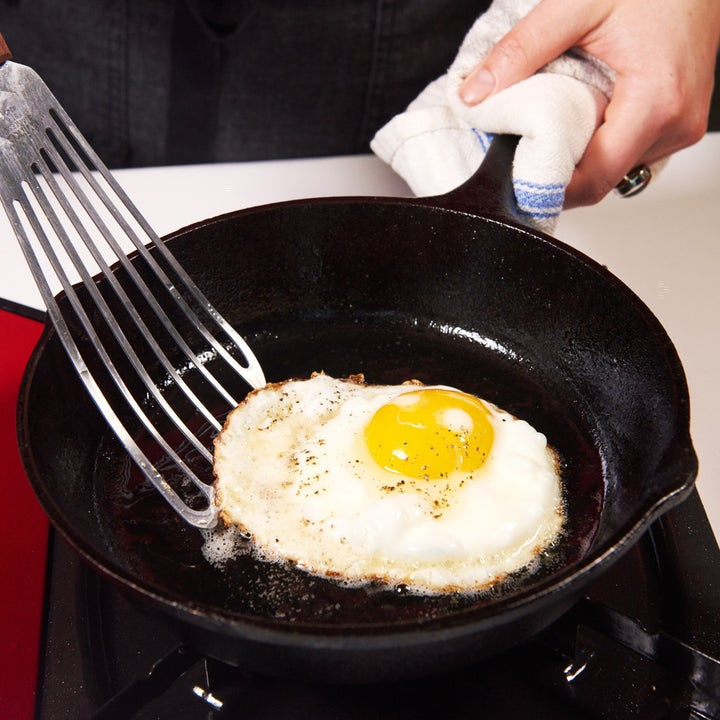 Flipping a fried egg.