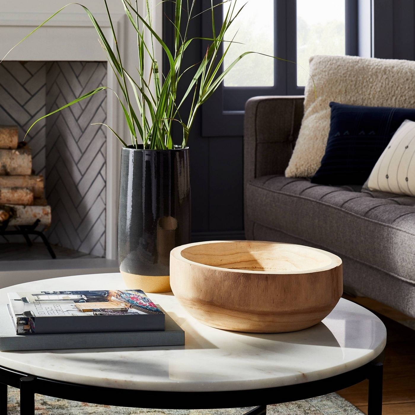 decorative wood bowl on a marble coffee table