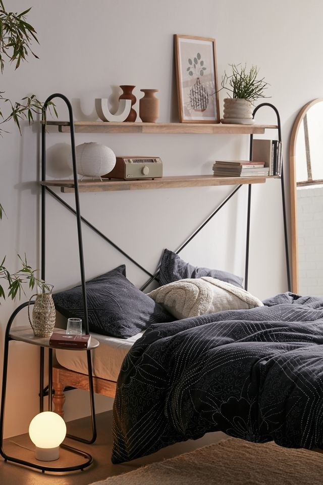 The shelf over a bed