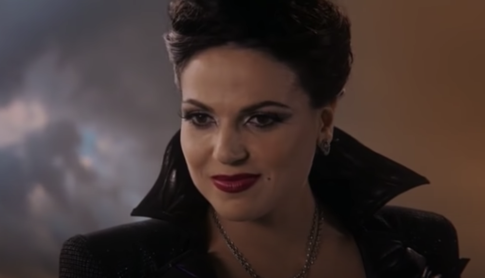 Regina as the evil queen grinning