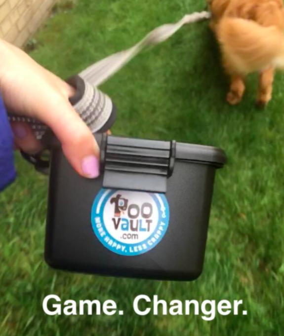 """Reviewer holding the poop holder with caption """"game changer"""""""
