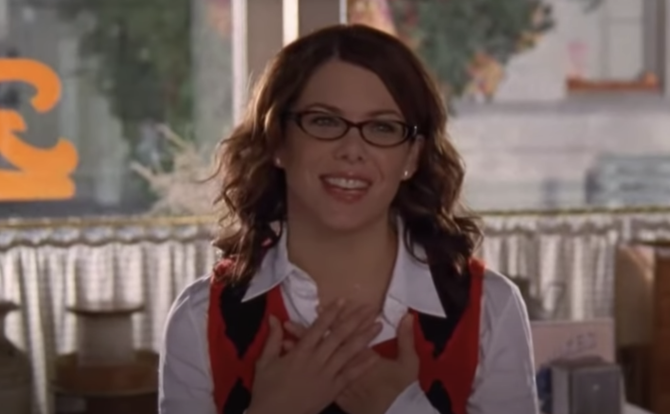 Lorelai smiling with her hands over her heart