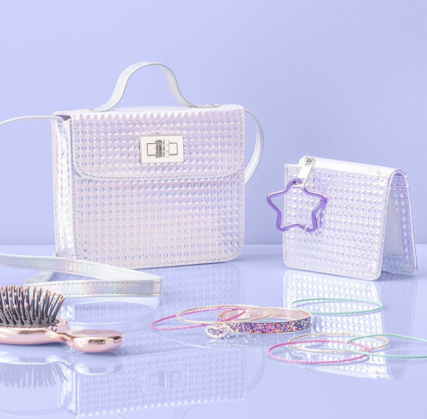A small hair brush, hair elastics and silver purses
