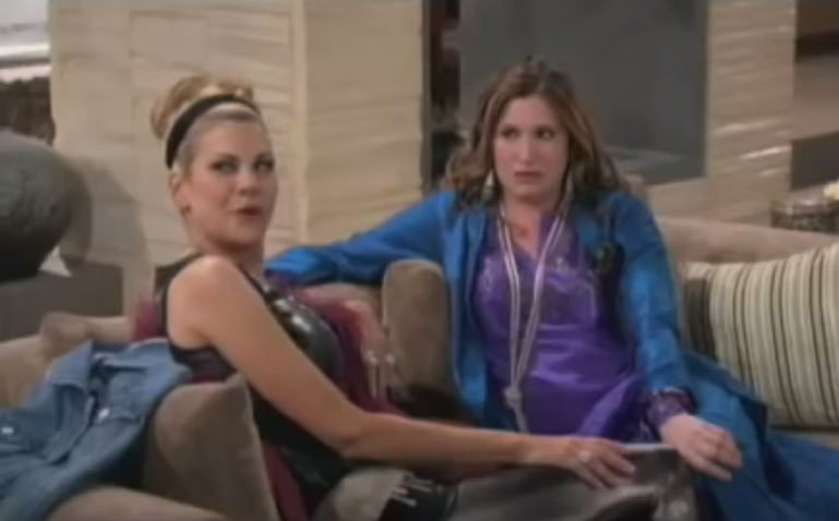 A screenshot of Kathryn and Kristen sitting on a couch