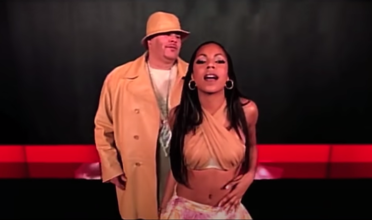 "Screenshot of Fat Joe and Ashanti dancing together in the video for ""What's Luv?"""