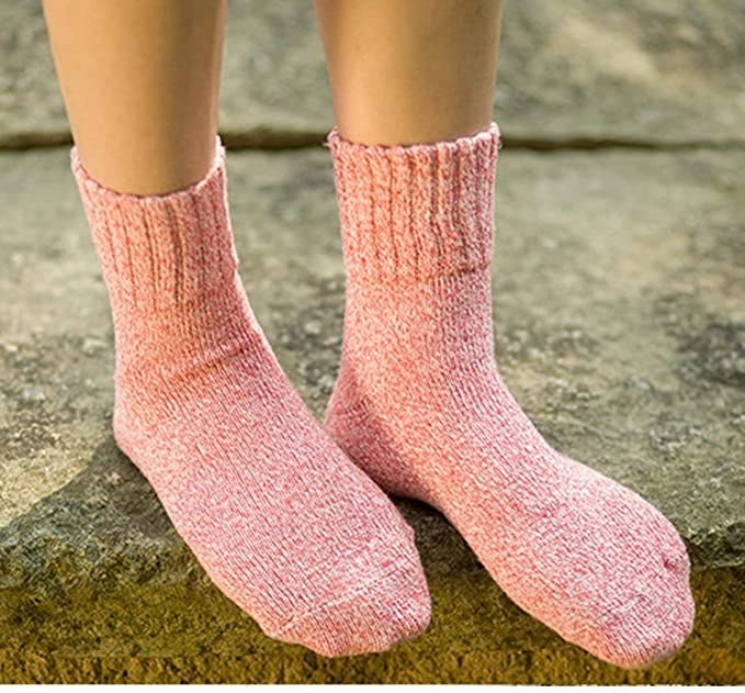 model's feet with the pink socks that go up about 4 inches past ankles