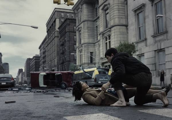 Barry leaning over Iris in the street after rescuing her