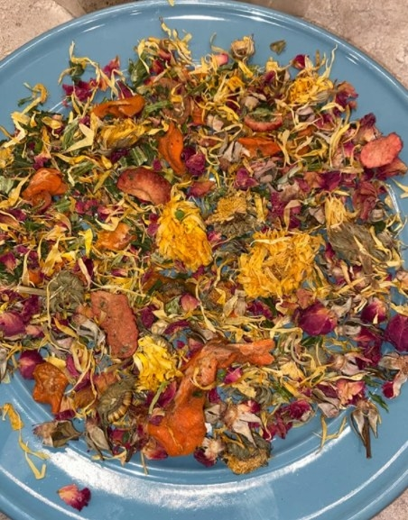 Reviewer's picture of the mix of dried plants in oranges, greens, yellows, and reds