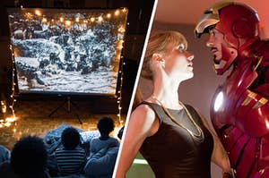 """A family sits on blankets on the floor in front of a pop up movie screen covered in fairy lights and Gwyneth Paltrow as Pepper Potts and Robert Downey Jr. as Tony Stark in the movie """"Iron Man 3."""""""