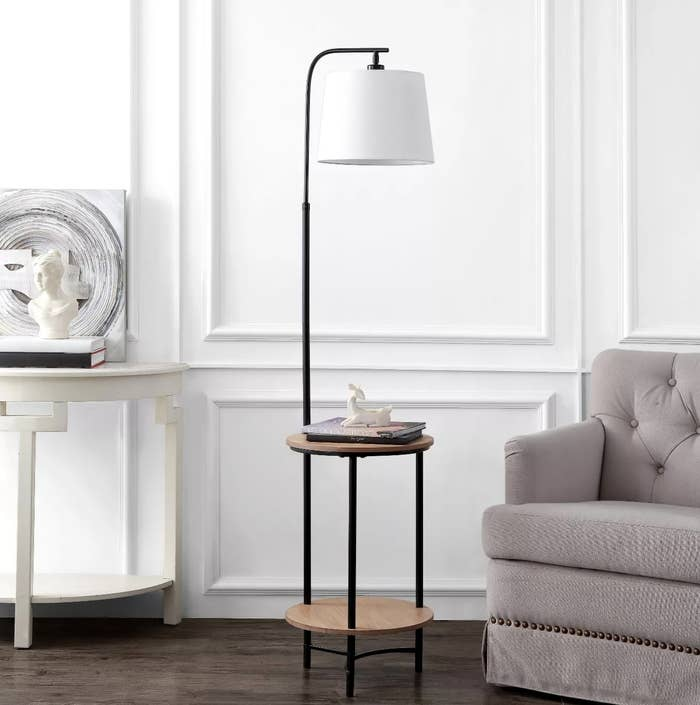 The wood and black metal floor lamp with two shelves