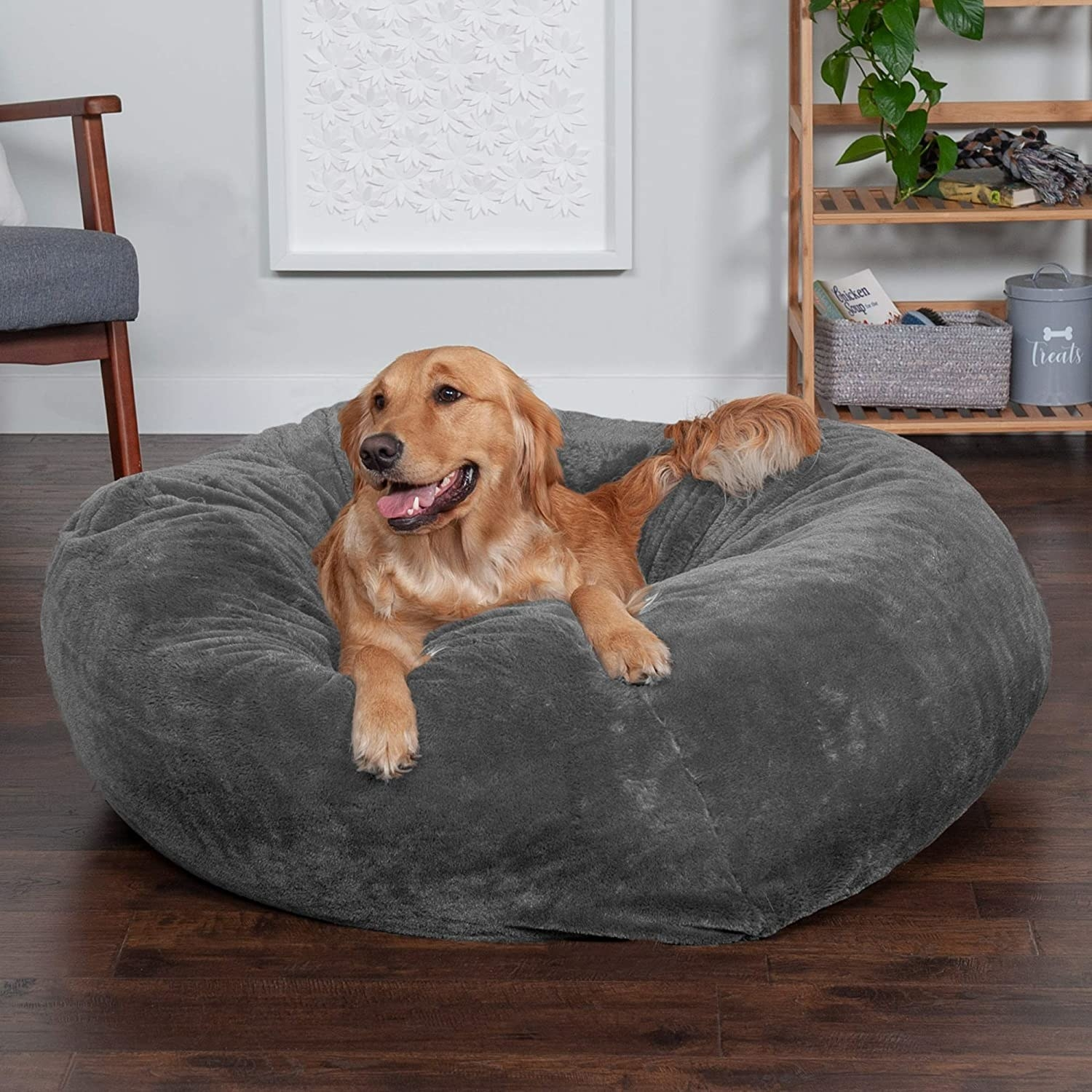 Dog resting on large pet bed