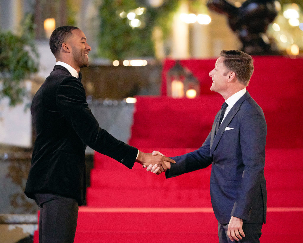 Matt shaking hands with Chris during his season of The Bachelor