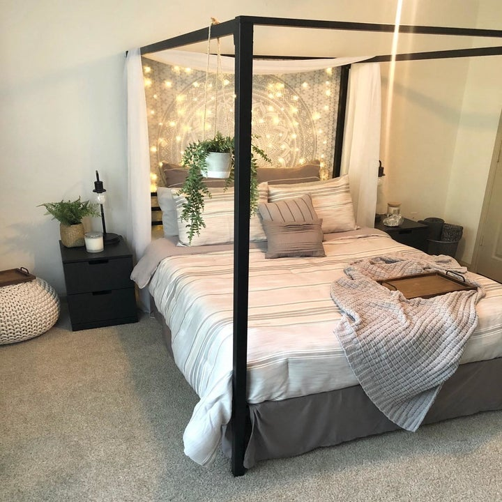 a reviewer's bed with string lights
