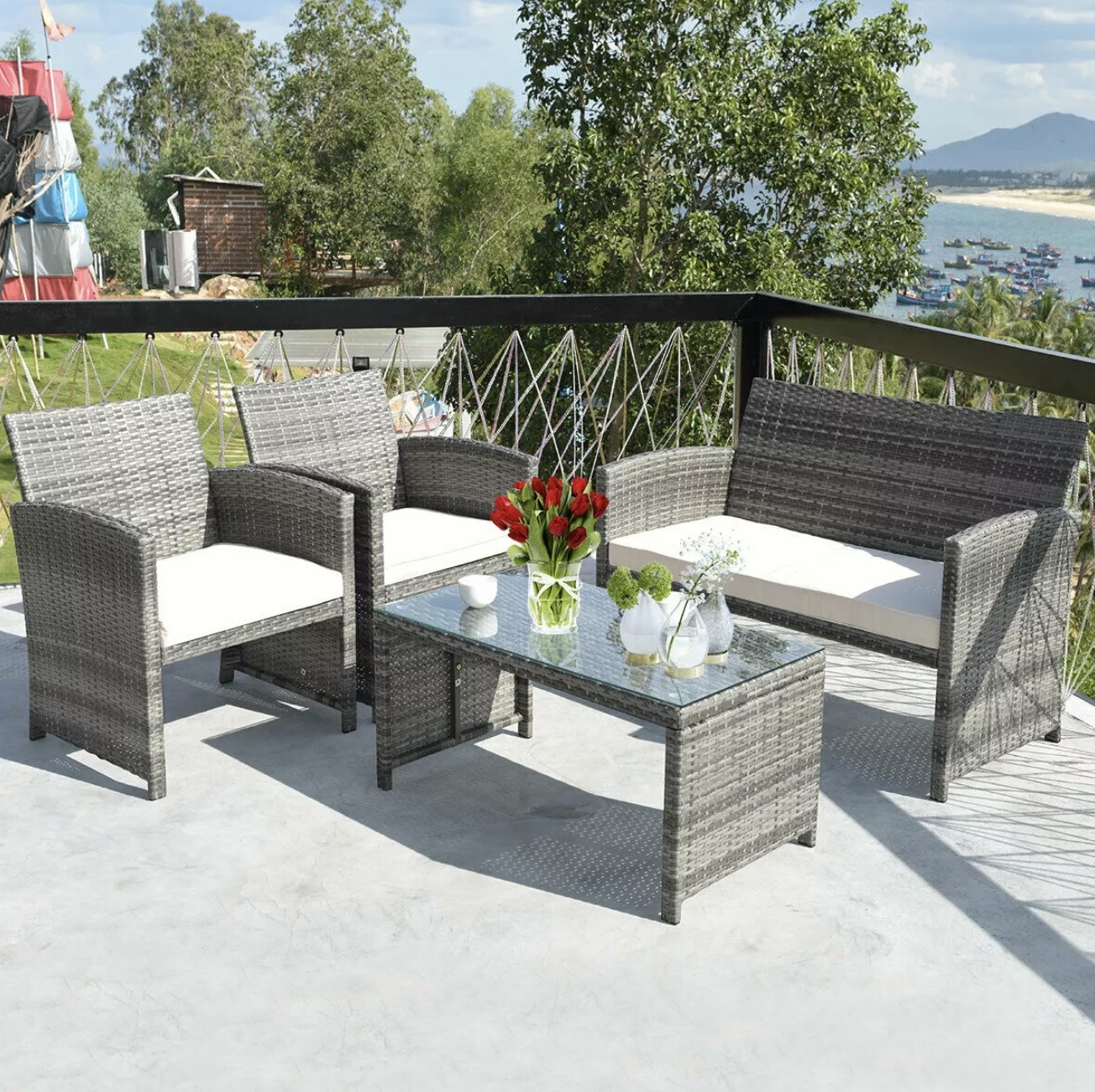 The patio set of three seats and a coffee table in a wicker material