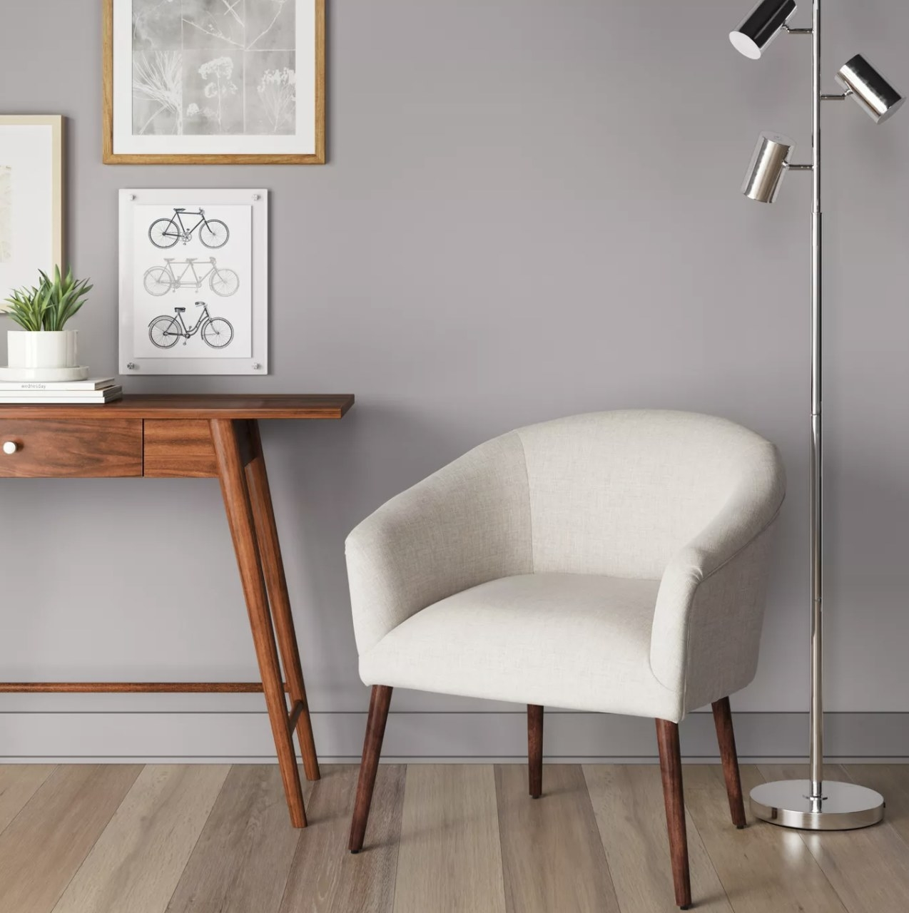 The white chair with wood legs