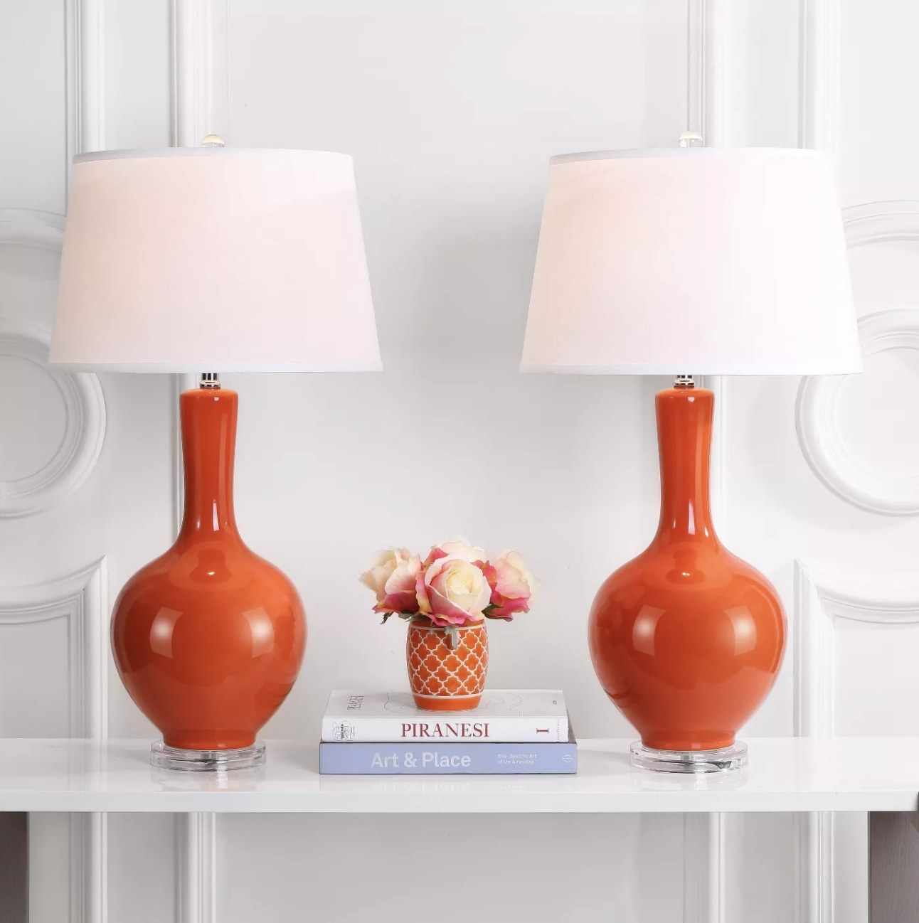 The two lamps with bright orange bases