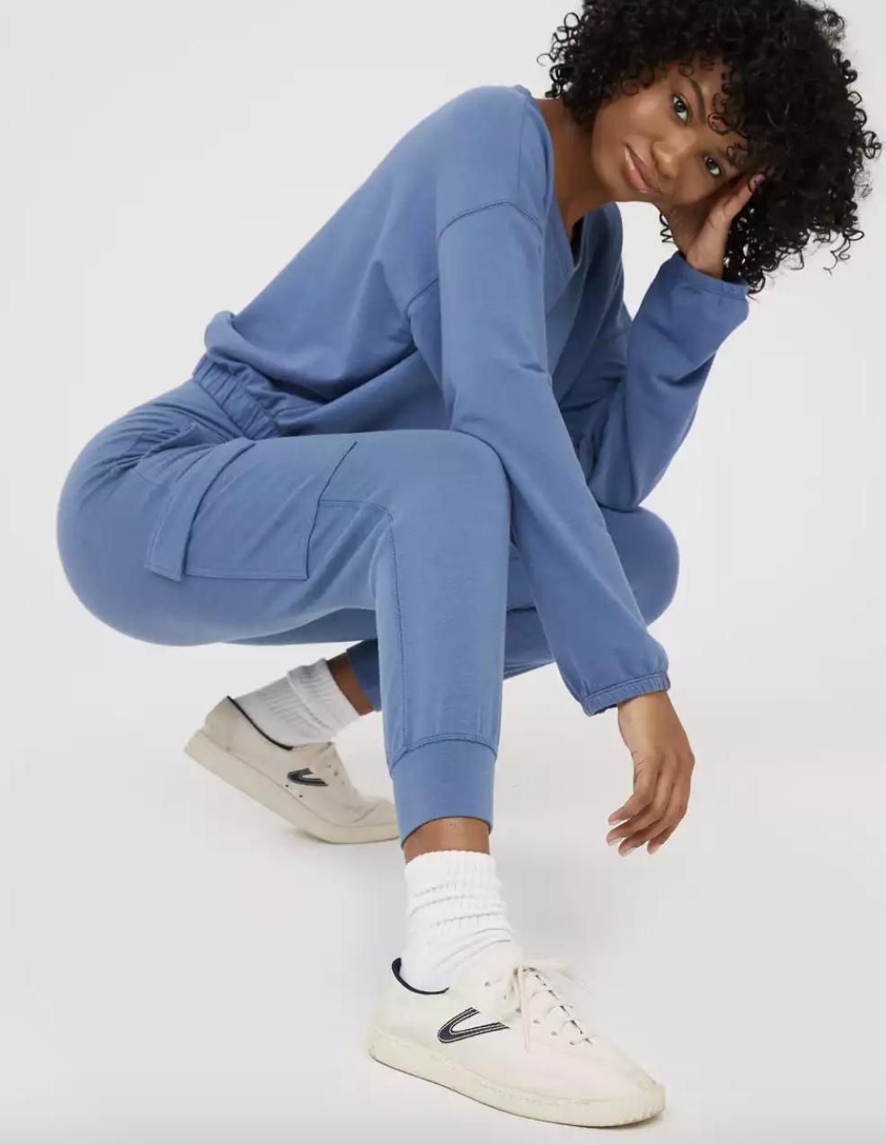 model wearing the blue cargo pants